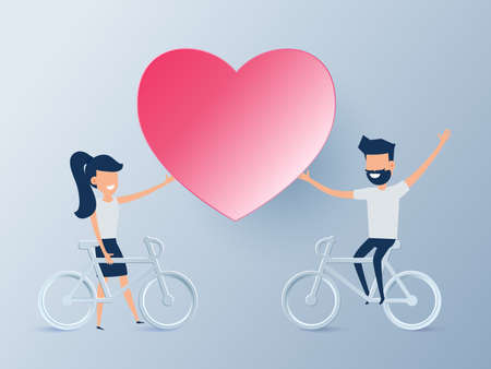 lovely couple: Happy valentines day concept of love. Lovely young couple riding a bicycle with heart.