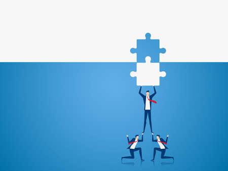 Business team places the final piece of a puzzle.Team support and help concept.