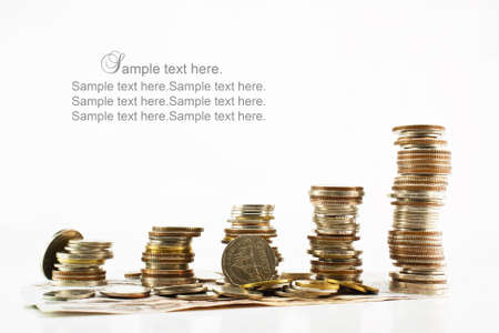 Stack of coins with bank notes isolated on white background Stock Photo