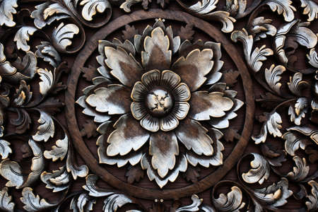 Pattern of flower carved on wood background  photo