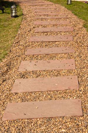 Stone walkway winding in garden photo