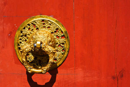 An old wood door handle knocker photo