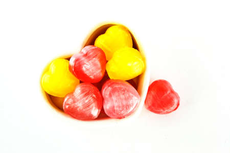 ceramicist: Creation of colorful heart-shaped candies isolated on white background