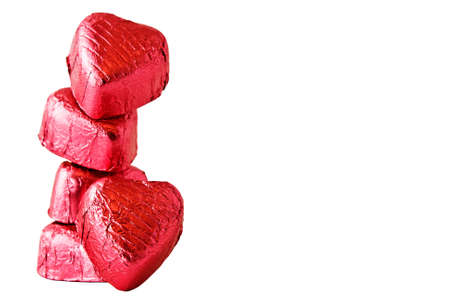 candy hearts: Stack of Chocolate heart candies on white background  Stock Photo