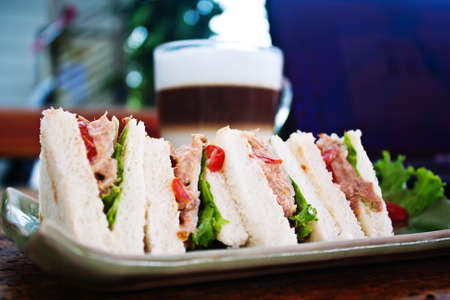 sandwich with coffee and laptop in relax time