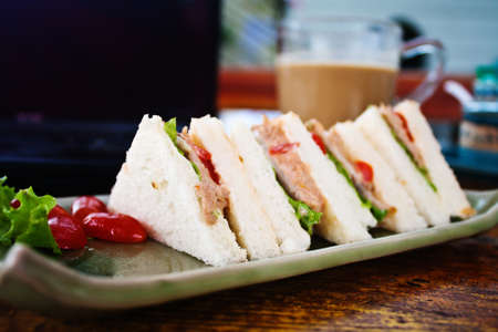 sandwich with coffee and laptop in relax time photo