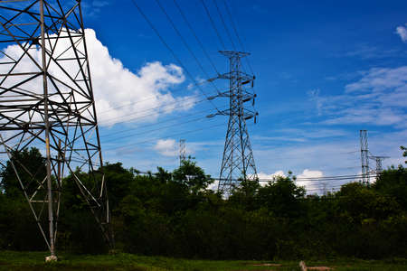 high voltage post.High-voltage tower blue sky background. Stock Photo - 13913980