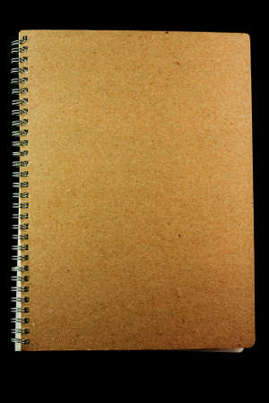 Brown book isolated on black background Stock Photo - 14573062