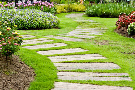 home garden: Landscaping in the garden. The path in the garden. Stock Photo