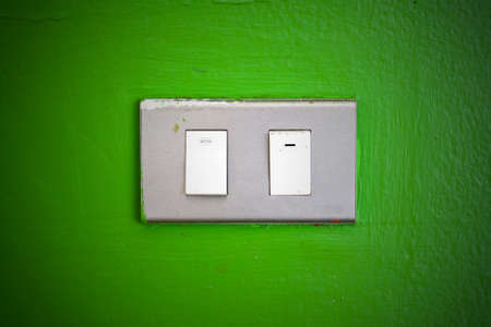 Grunge electric switch on colorful concrete wall photo