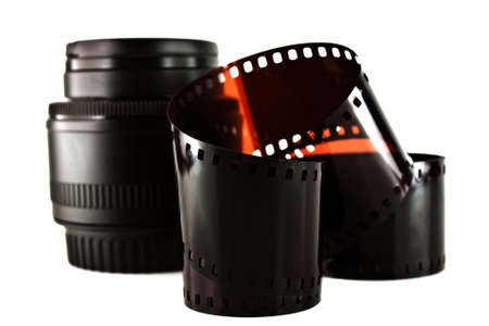 film strip and lens isolated on white background  photo