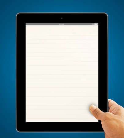 Hands with blank lined page tablet computer photo