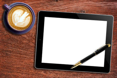 Blank Tablet,pen and cup of coffee on wooden background photo
