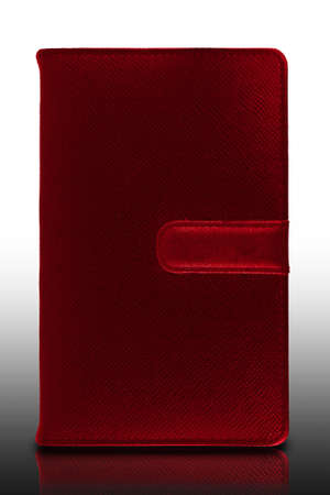 colorful leather cover book or notebook with reflect isolated on white background photo