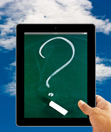 Hands with  question mark  screen tablet computer on blue sky background photo