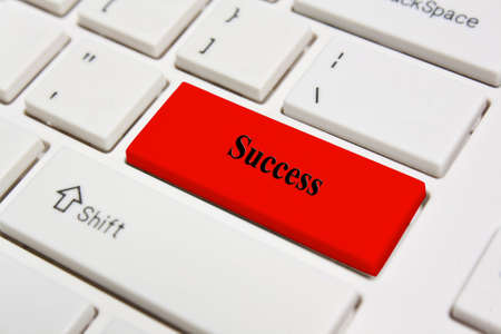 White Keyboard with red Success key Stock Photo - 15381469