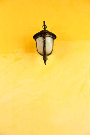 castle wall: Lantern on a yellow wall