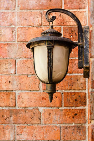 Street lamp on a textured brick wall photo
