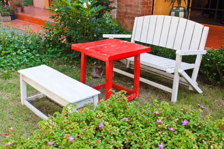 Vintage wooden bench in the garden photo