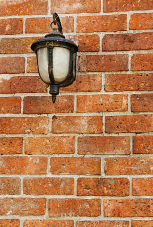 Street lamp on a textured brick wall Stock Photo - 16156449