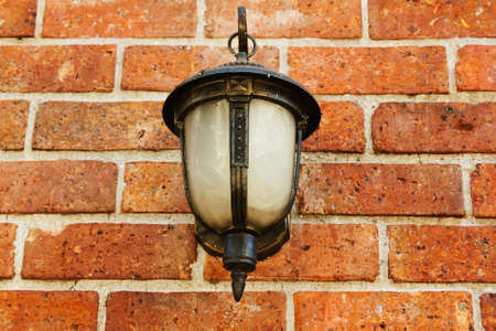 Street lamp on a textured brick wall Stock Photo - 16156267