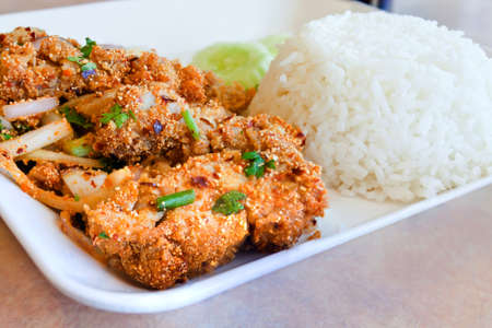 Spicy chicken served with rice,asian food,Thailand. photo