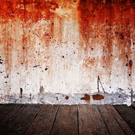 Wood floor with grunge concrete wall photo