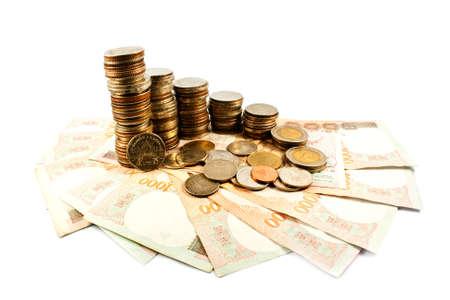 硬貨および現金、白い背景で隔離のスタック 写真素材