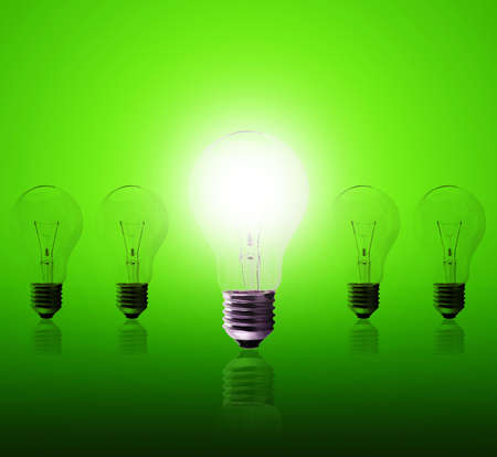 Light bulb lamps on a green background photo