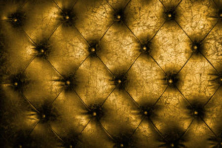 Luxury golden leather close-up background with great detail for background Standard-Bild