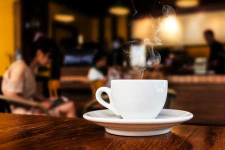 shop interior: cup of coffee on table in cafe  Stock Photo
