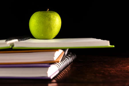 Open book with green apple photo