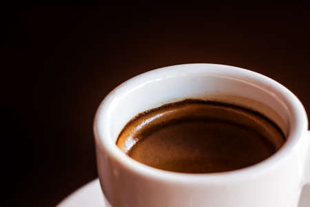 White cup of coffee on wooden background Stock Photo