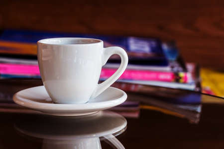 cup of coffee on table in cafe photo