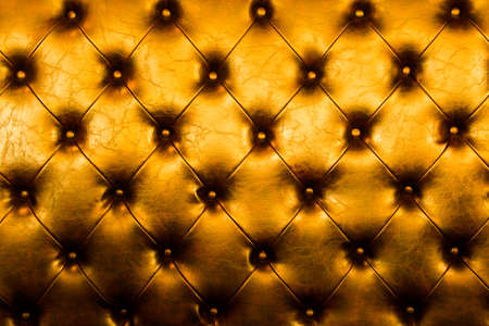 Luxury golden leather close-up background with great detail for background photo