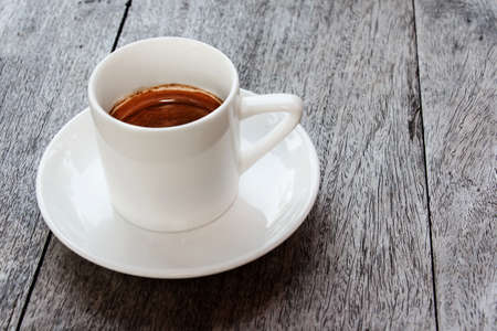 Coffee cup on wood table with copy space. photo