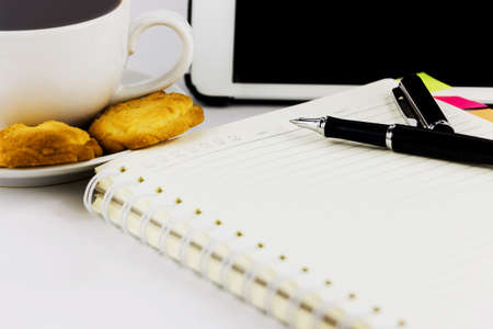 Cup of coffee,tablet computer,book and pen isolated on white background. photo