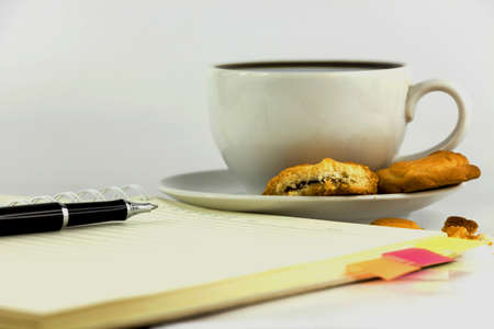 cup of coffee,cookies,notebook and pen isolated on white background. photo