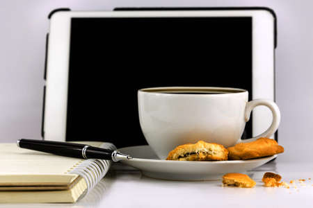 Cup of coffee,tablet computer,book and pen isolated on white background. Stock Photo - 23317102