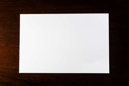 Blank white paper on wooden background.Still life photography photo