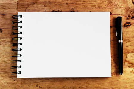 close up opening note paper and pen on wood texture background with copy space Stock Photo