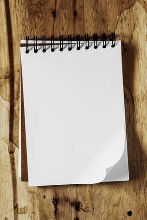Sketchbook against wood background photo