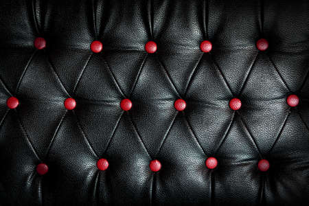 abstract black Leather against red dot Standard-Bild