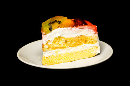 fruit Cake isolated on black background photo