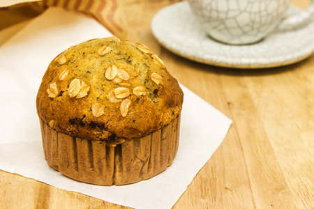 Almond muffins with coffee cup on wood table photo