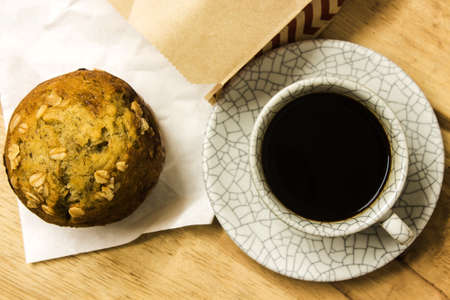 Almond muffins with coffee cup on wood table,top view. photo