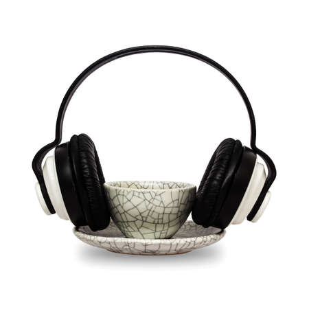 Coffee mug and headphones isolated on white background with clipping path. photo