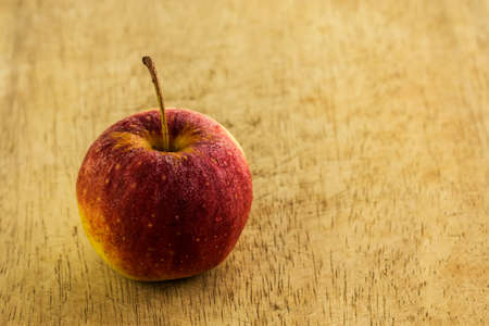 close up to fresh red apple  on wood table photo