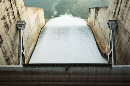 thai dam: water flowing in a Dam Stock Photo