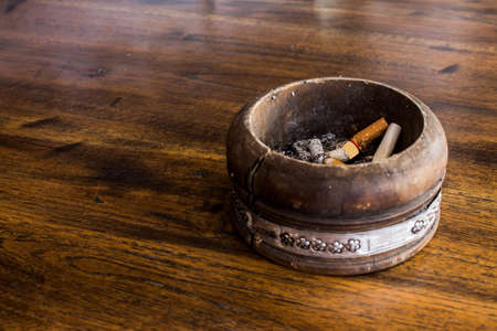 Vintage wood ashtray on table photo